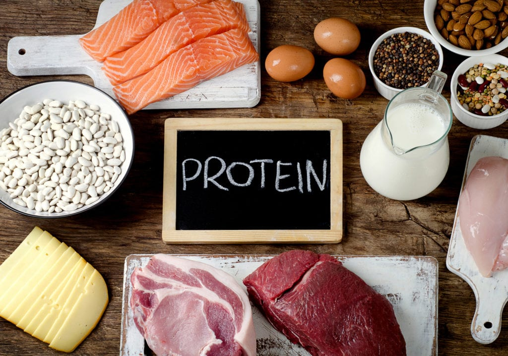 Best Foods High in Protein on wooden background. Healthy eating and diet concept