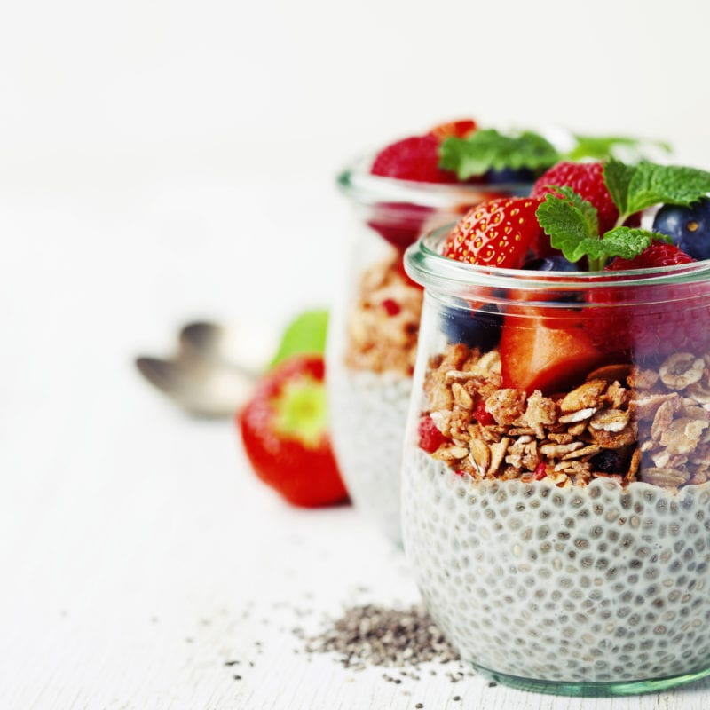 Сhia seeds vanilla pudding and berries on wooden rustic background - Healthy food, Diet, Detox, Clean Eating or Vegetarian concept.